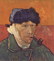 Portrait of a clean shaven man wearing a furry winter hat and smoking a pipe; facing to the right with a bandaged right ear en.m.wikipedia.org/wiki/File:Vincent_Willem_van_Gogh_106.jpg